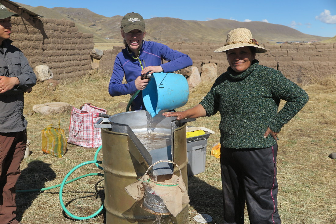 Dr. BrieAnna Langlie and Virginia processing archaeological sediments by flotation in the village of Totorani.
