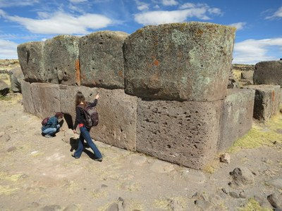Lauren and Erika inspecting an Inca chulpa (burial tomb) during a visit to Sillustani.