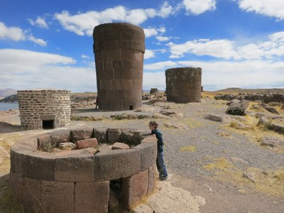 Lauren inspects an Inca chulpa (burial tomb) during a visit to Sillustani.