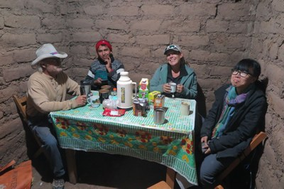 Bill, Dani, Bryna, and Jenny enjoy tea in the Totorani field house after a day of excavation.