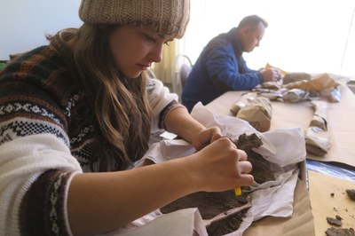 Alex and Jim carefully clean delicate bone artifacts.