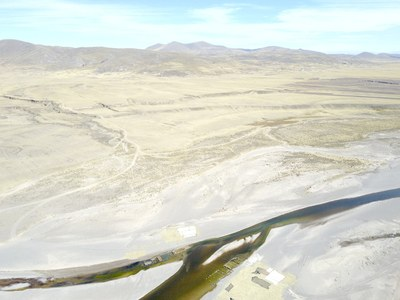Drone's eye view of the field site located over 3800 meters in altitude in the Department of Puno, Peru. The site of Wilamaya Patjxa--the focus of the investifations--is approximately in the center. Rio Huenque in the foreground.