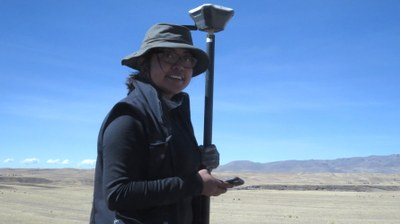 Jessica using the GNSS unit to map features.